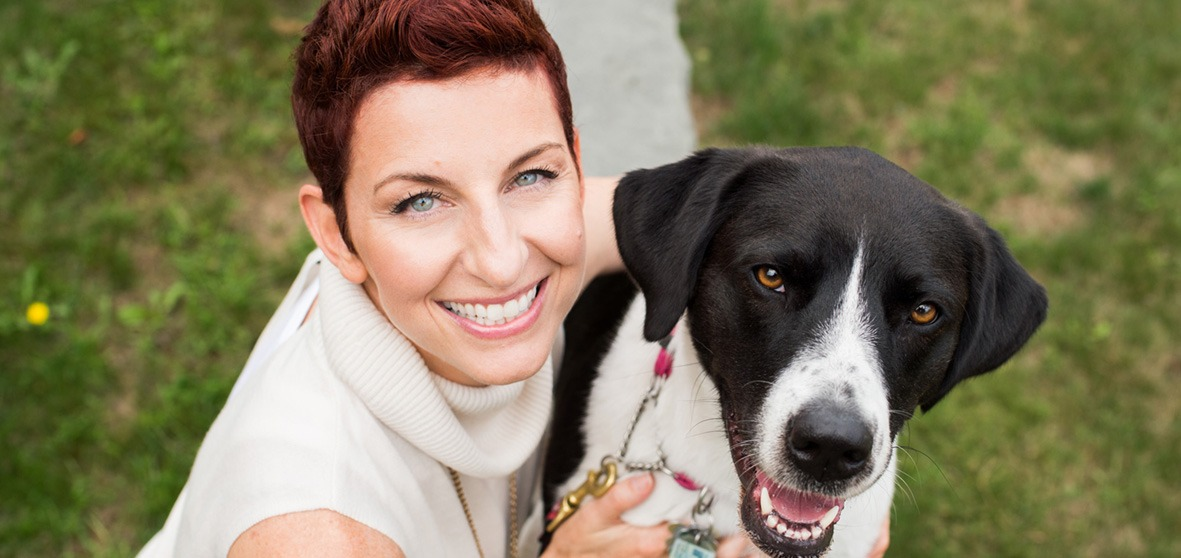 danielle mackinnon headshot with dog tuukka